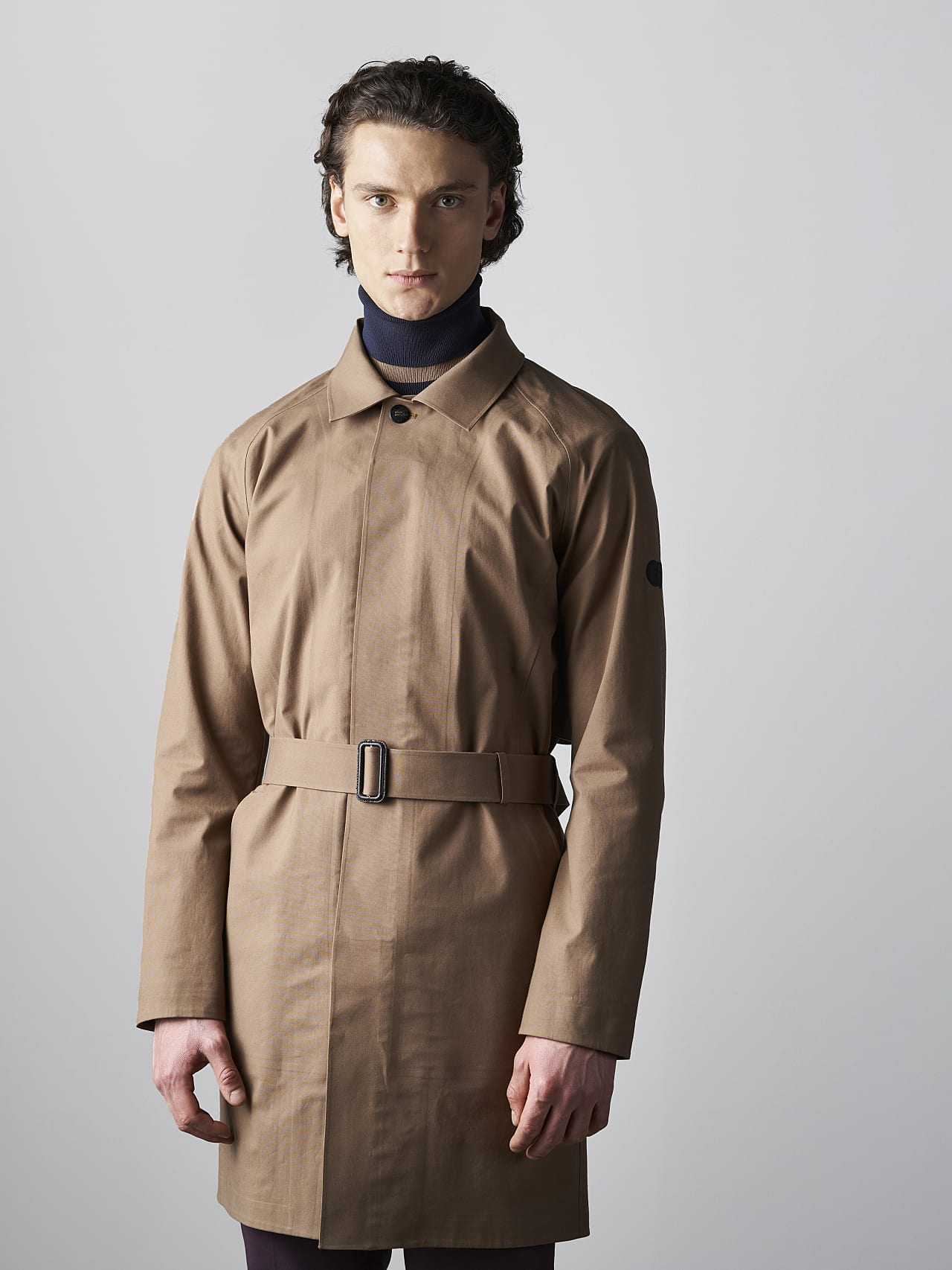 OMANA V1.Y5.02 Packable and Waterproof Trench Coat gold Model shot Alpha Tauri