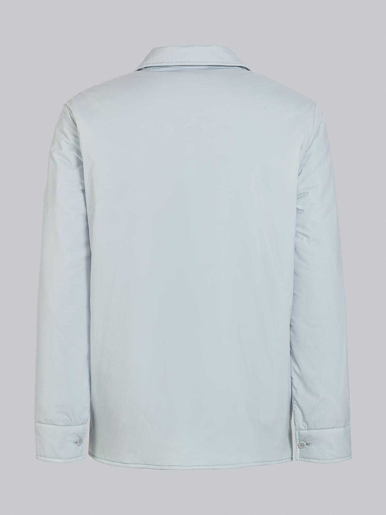 OVASU V1.Y5.02 PrimaLoft® Overshirt Jacket Pale Blue  Left Alpha Tauri
