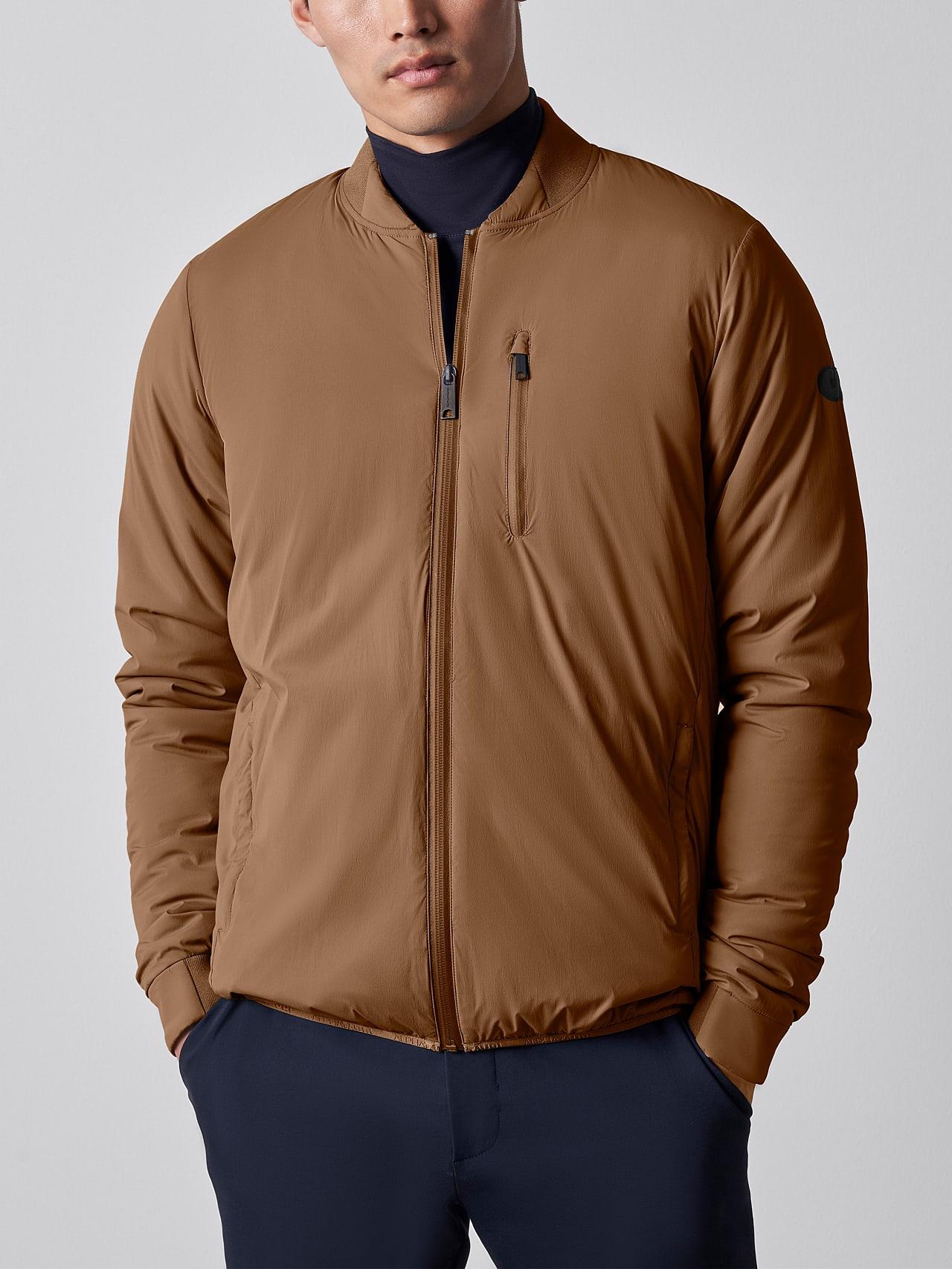 OPRIM V3.Y5.02 Padded PrimaLoft® Jacket gold Model shot Alpha Tauri