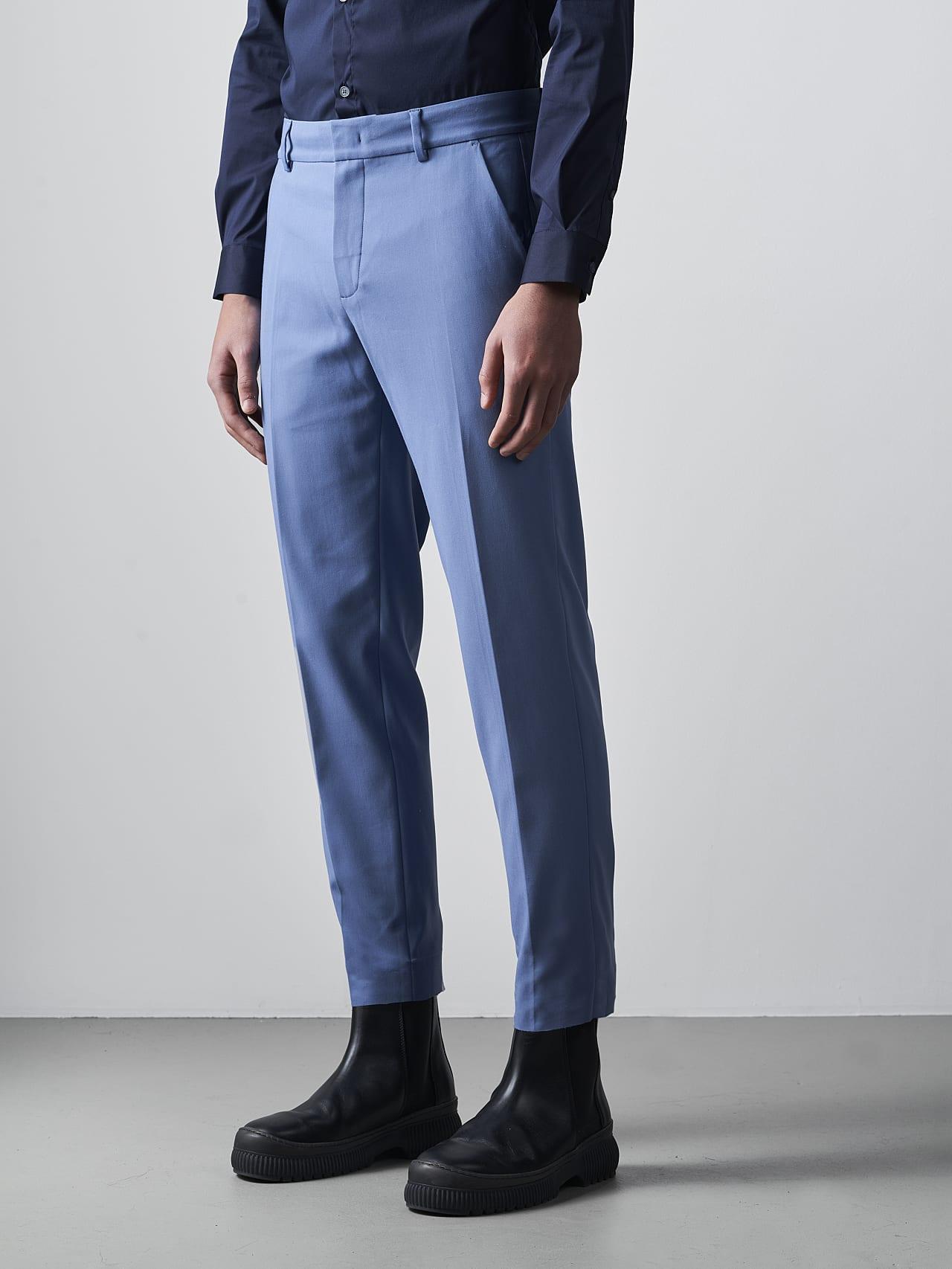 PELAN V1.Y5.02 Tapered Pants with Pleats light blue Model shot Alpha Tauri