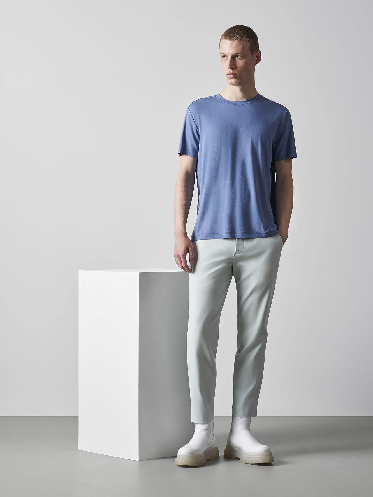 PELAN V1.Y5.02 Tapered Pants with Pleats Pale Blue  Model shot Alpha Tauri