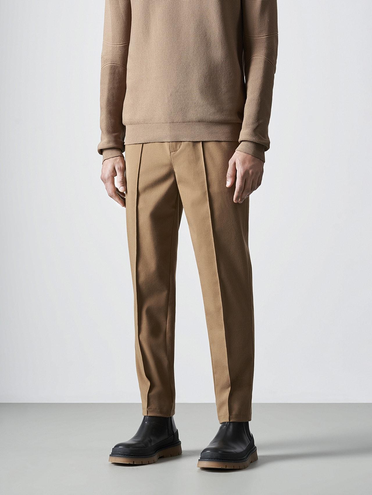 PANZA V1.Y5.02 Slim Pleat Trousers gold Model shot Alpha Tauri