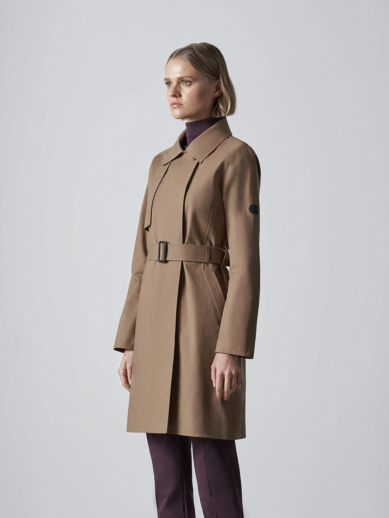 OMANI V1.Y5.02 Packable and Waterproof Trench Coat gold Model shot Alpha Tauri