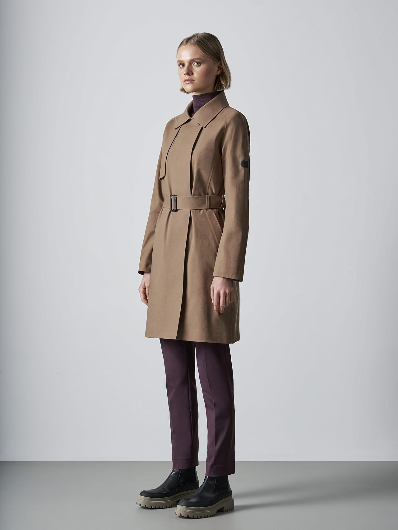 OMANI V1.Y5.02 Packable and Waterproof Trench Coat gold Front Alpha Tauri