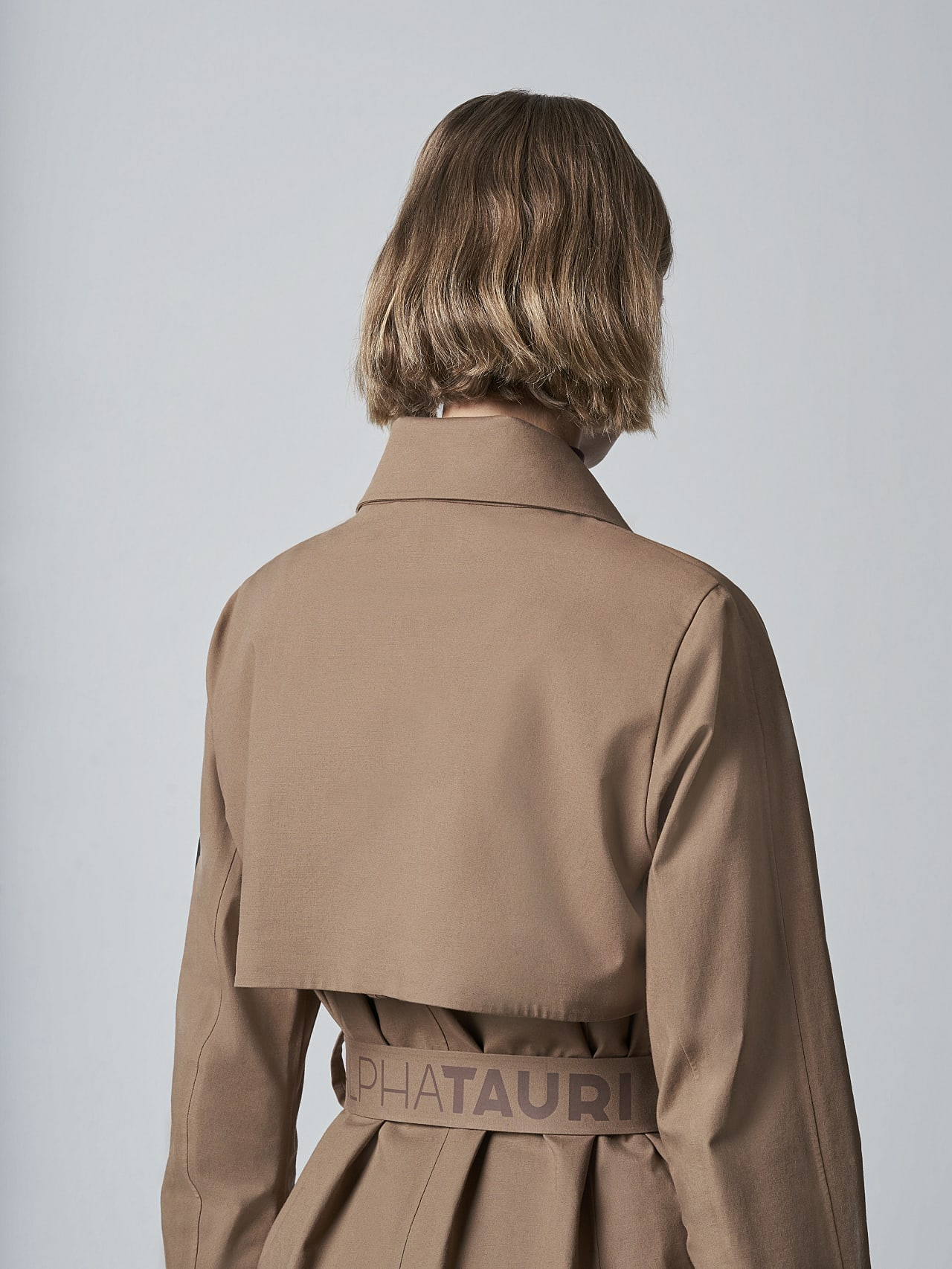 OMANI V1.Y5.02 Packable and Waterproof Trench Coat gold Extra Alpha Tauri