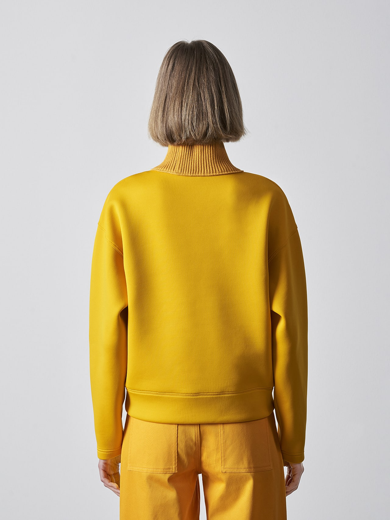 SINAE V1.Y5.02 Technical Turtle-Neck Jumper yellow Front Main Alpha Tauri
