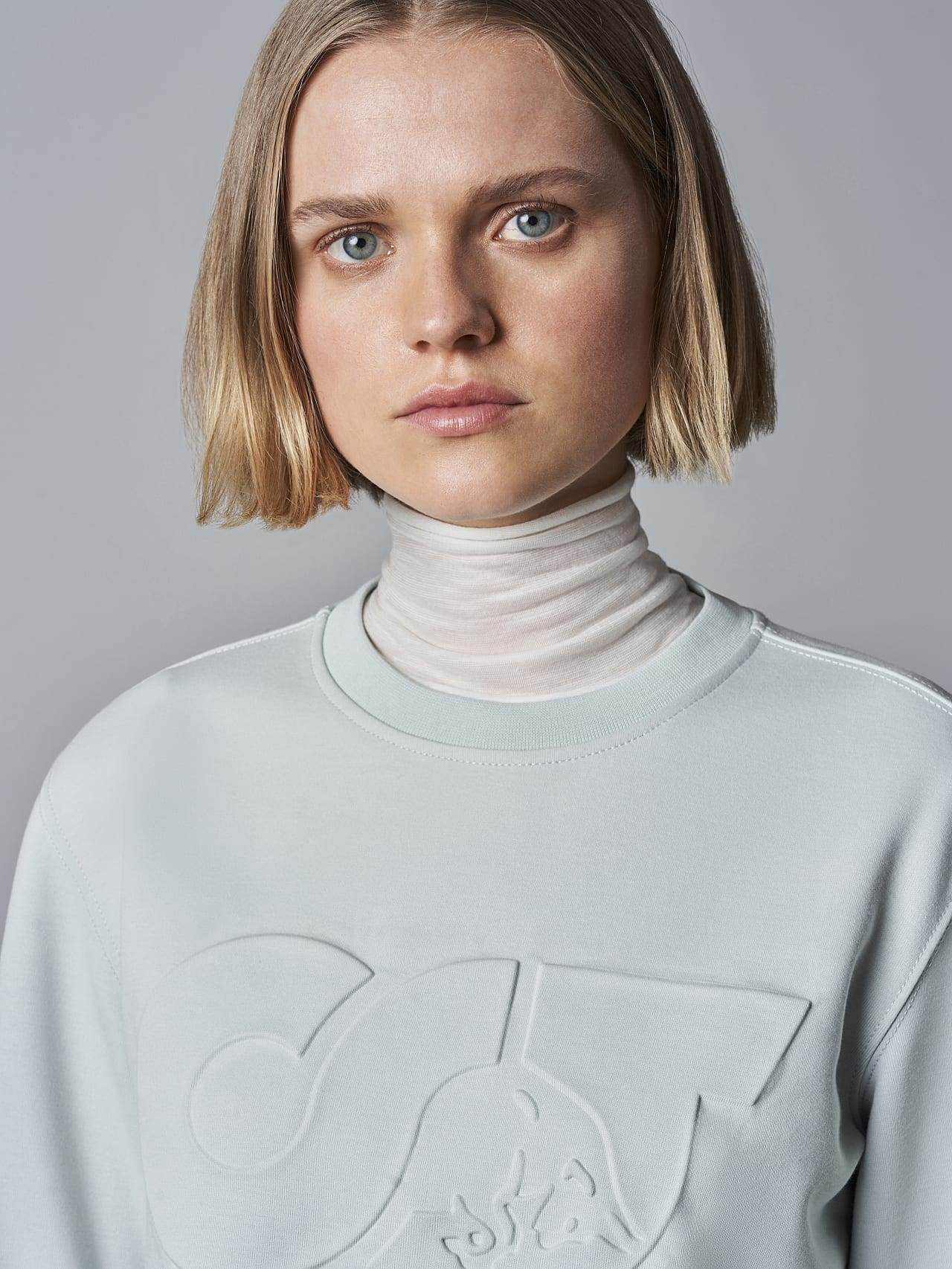 SHINT V1.Y5.02 Premium Logo Sweater Pale Blue  Right Alpha Tauri