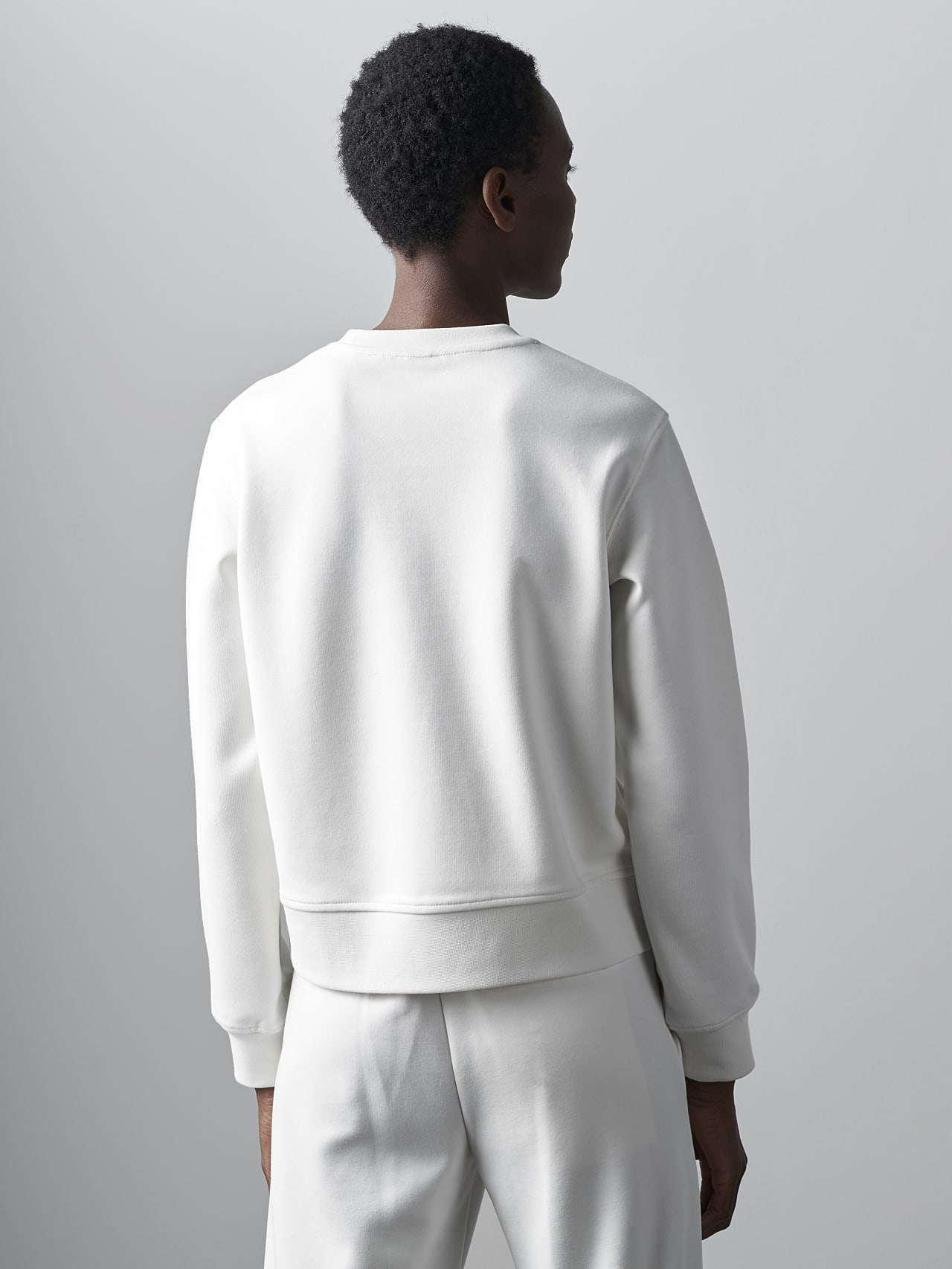 SHINT V1.Y5.02 Premium Logo Sweater offwhite Front Main Alpha Tauri