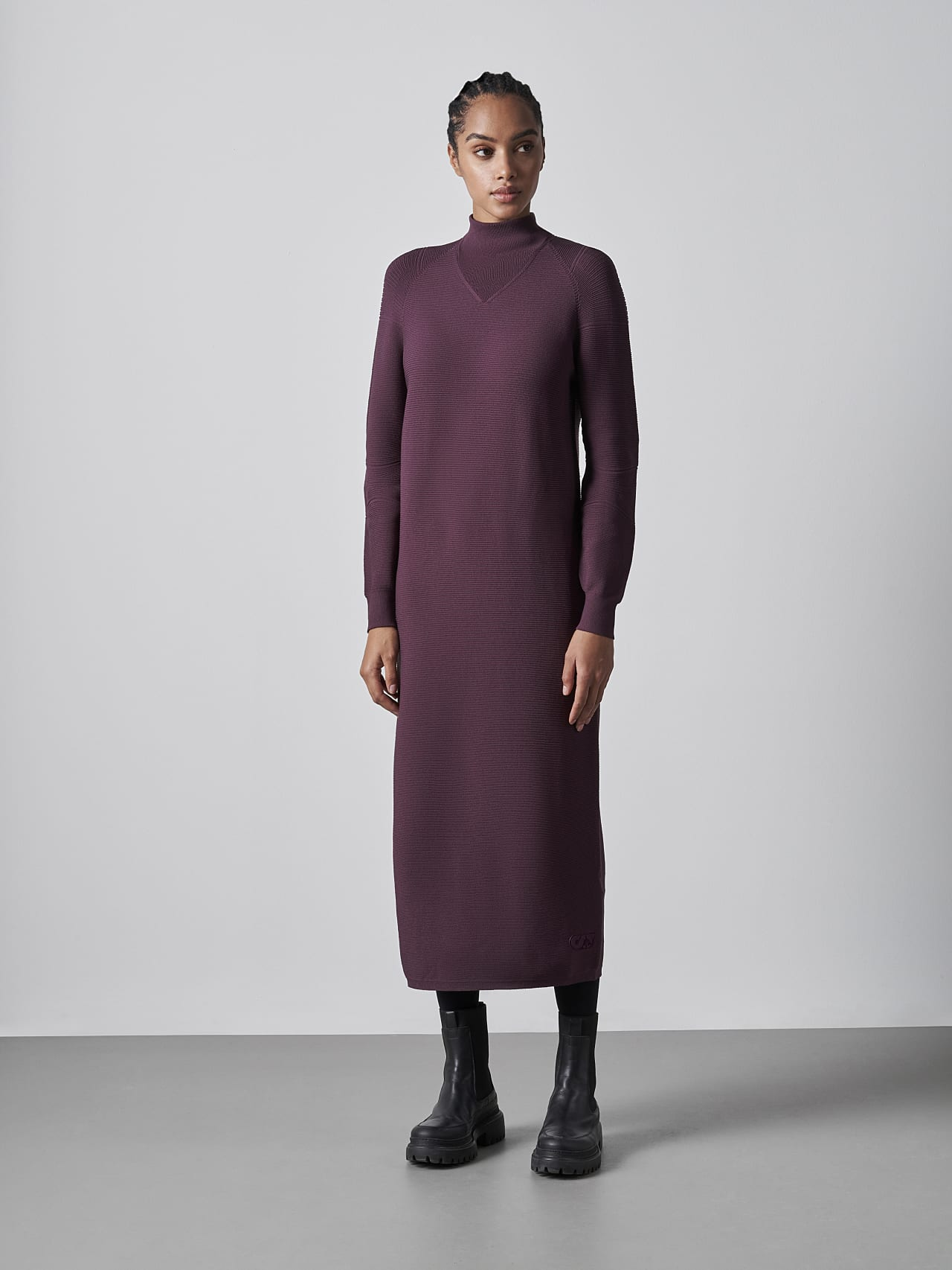FOXEE V1.Y5.02 Seamless 3D Knit Mock-Neck Dress Burgundy Model shot Alpha Tauri