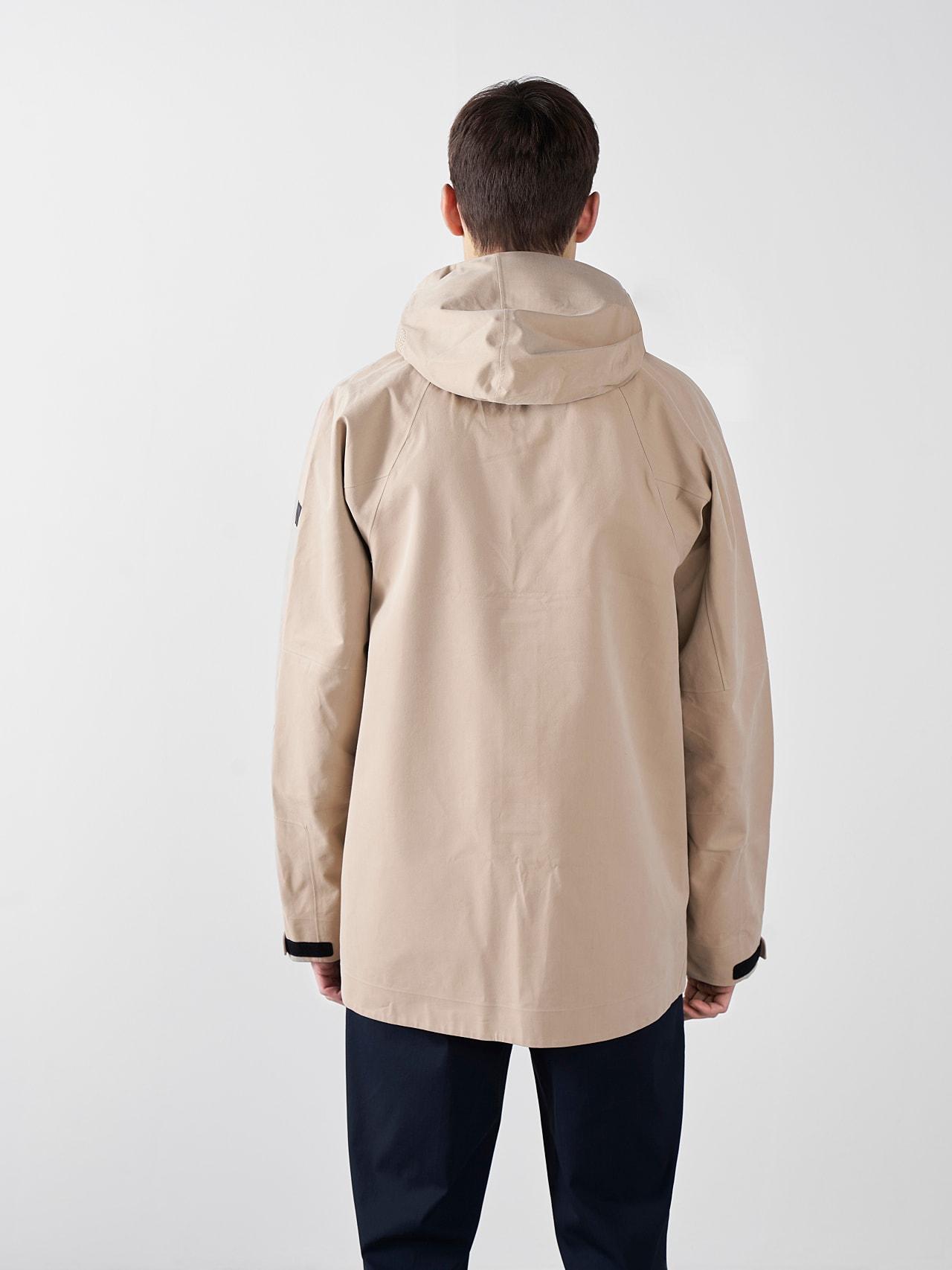 OKOVO V3.Y5.01 Packable Waterproof Jacket Sand Front Main Alpha Tauri