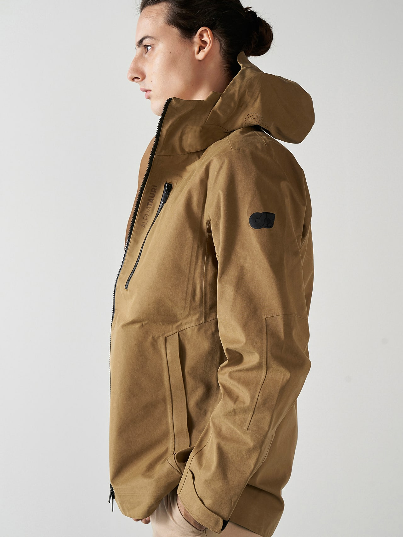 OKOVO V3.Y5.01 Packable Waterproof Jacket brown Model shot Alpha Tauri