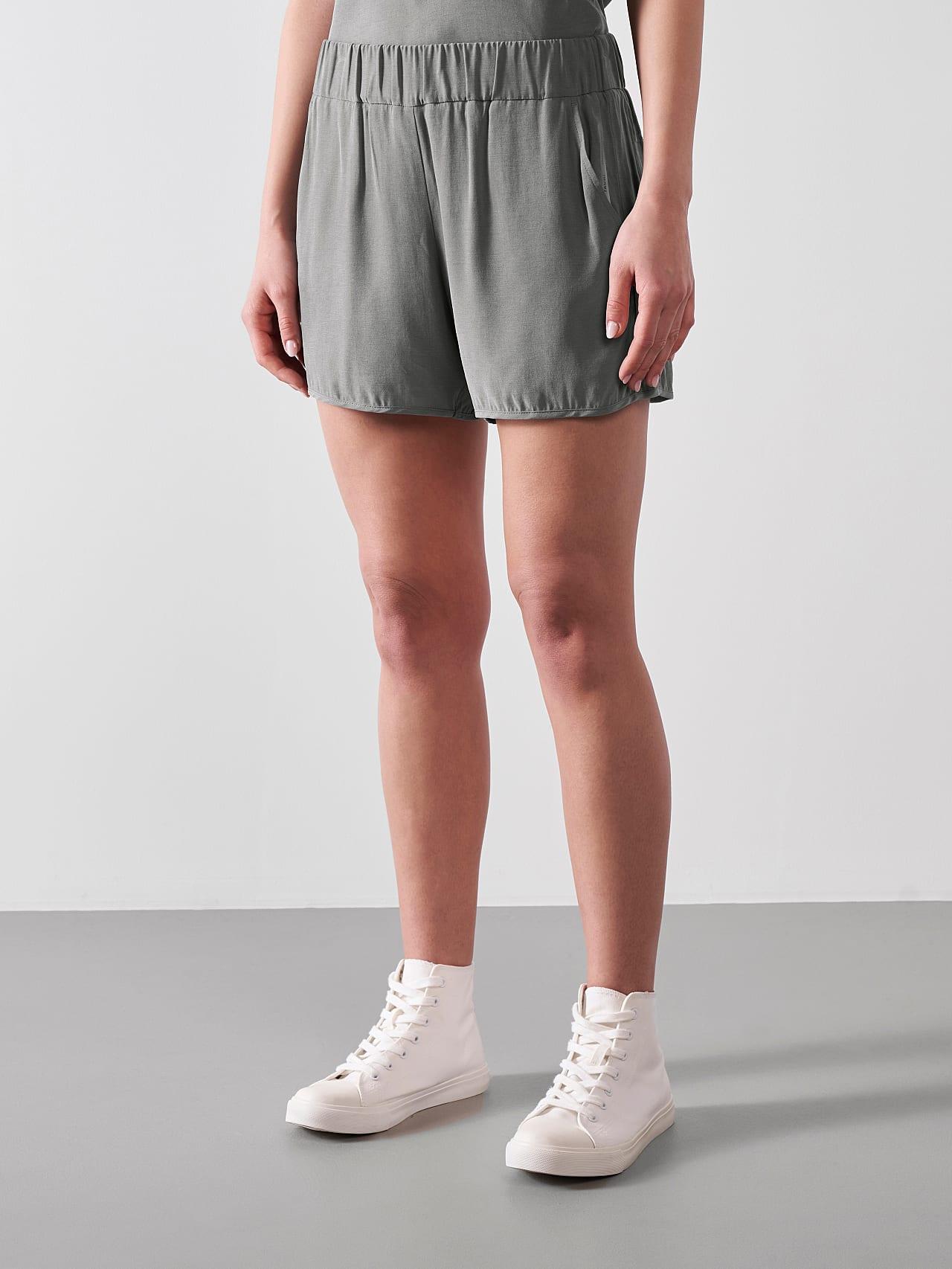 PHORT V1.Y5.01 Relaxed Cupro Shorts Grey Model shot Alpha Tauri